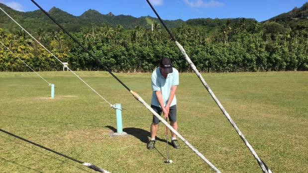Getting wired on Rarotonga's golf course.